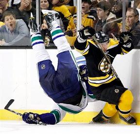 Brad Marchand ducks a Sami Salo hit