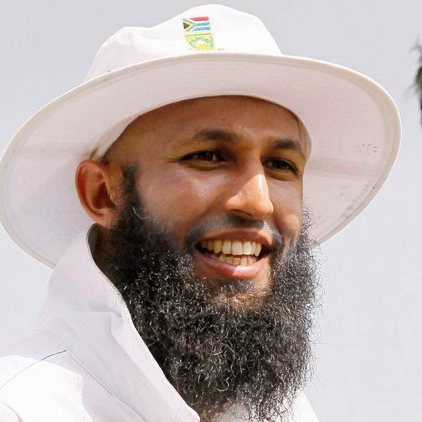 South African test cricket captain Hashim Amla smiles after South Africa defeated Sri Lanka by 153 runs in their first test cricket match in Galle, Sri Lanka, Sunday, July 20, 2014.