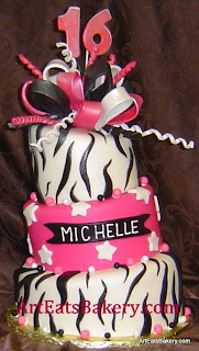Three tier zebra stripe black, white and hot pink custom fondant mad hatter sweet 16 birthday cake