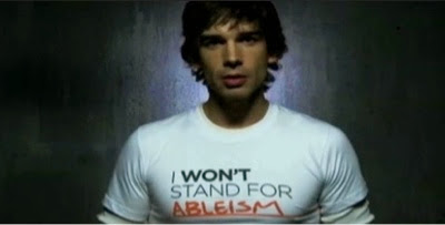 Chris Gorham wearing a tshirt that says I won't stand for ableism