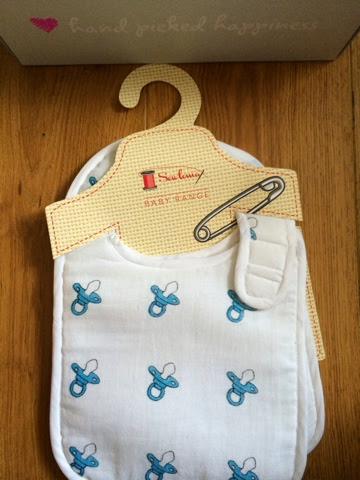 Baby Bib, white with blue dummy pattern on