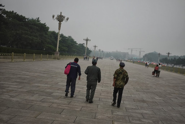 three men walking at Tiananmen Square
