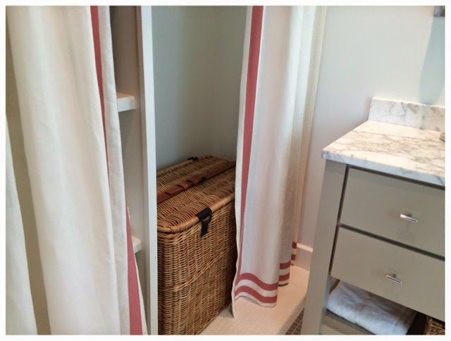 Curtains covering closet inside girls bathroom.  2014 Southern Living Idea House in Palmetto Bluff, SC | The Lowcountry Lady