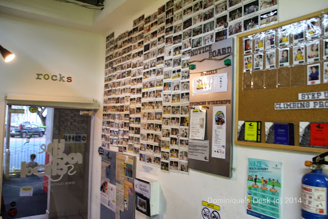 The inside wall plastered with photos of participants.