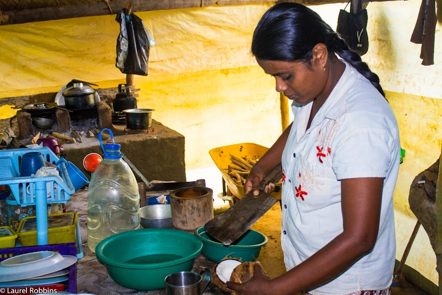 Learning how to make Coconut Sambol from a Sri Lankan farmer's wife as part of an experiential travel program.