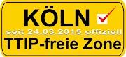 Banner, wie ein Ortseingangsschild: »Köln TTIP-freie Zone. Seit 24.03.2015 offiziell«.