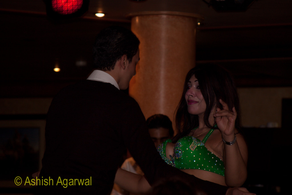 Passenger dancing with belly dancer in the Nile river cruise ship