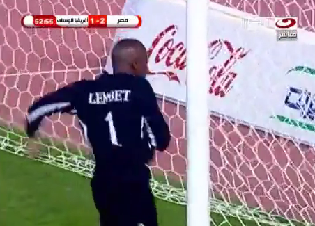 Mad Meltdown: Central African Republic keeper Geoffrey Lembet goes boxing crazy on the goalpost
