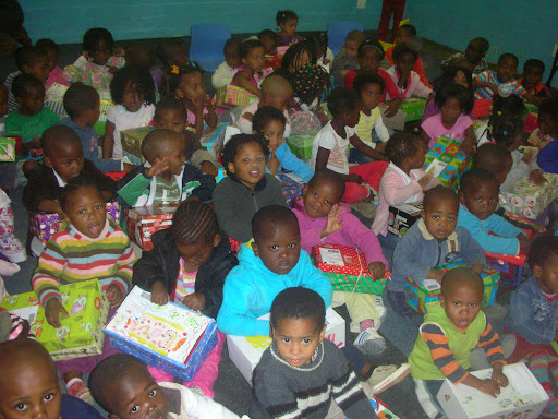 Children getting christmas gifts from All Out Africa at Angels & Starfish Nicki and Emily's placement .jpg