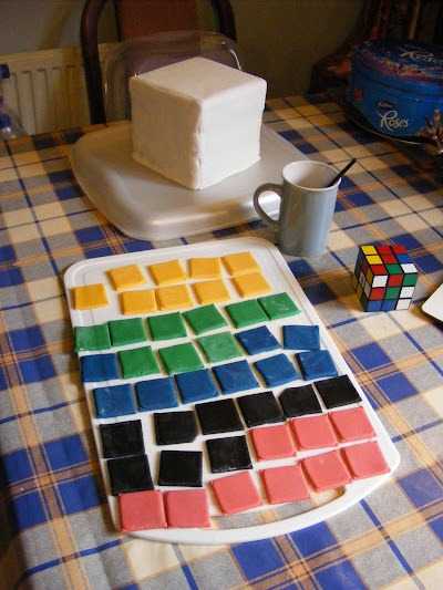 Coloured squares cut from icing to form the cubes
