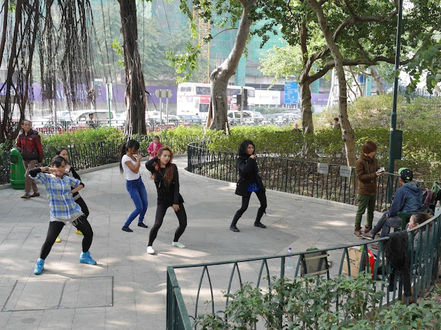 five women in the middle of a dance routine at the King George V Memorial Park in Kowloon, Hong Kong
