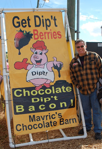 Festival visitors, including my husband, John, flock to the chocolate dipped bacon stand
