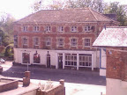 Large detached Victorian wharf warehouse given over to antiquities