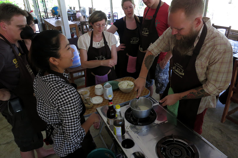Making the sticky rice with coconut cream, palm sugar and salt.