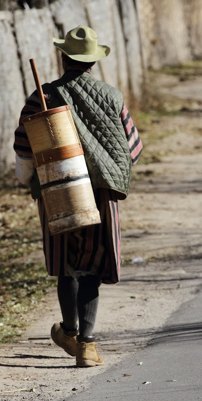Traditional Bhutanese man walking the streets of Bumthang, Bhutan