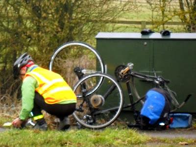 man fixing wheel