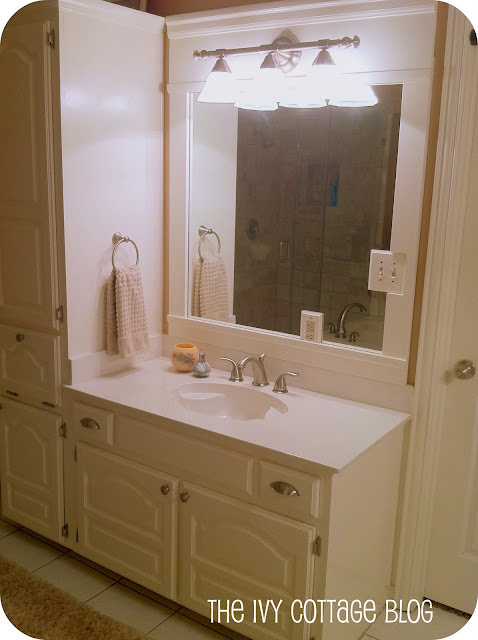 Inspirational Hubby us vanity with fresh paint new faucet and lighting as well as a customized frame on the mirror