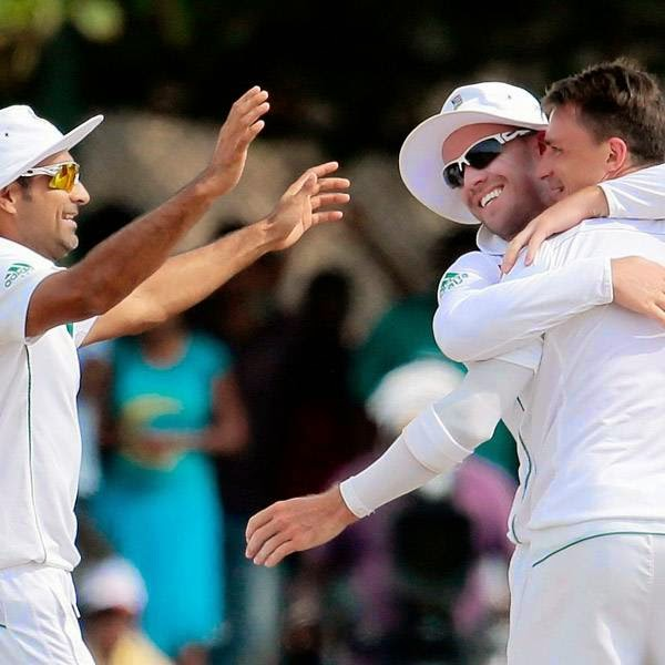 South African bowler Dale Steyn, right, is congratulated by teammates Imran Tahir, left, and AB de Villiers for the dismissal of Sri Lankan batsman Upul Tharanga, unseen, during the fourth day of the first test cricket mach between Sri Lanka and South Africa in Galle, Sri Lanka, Saturday, July 19, 2014.