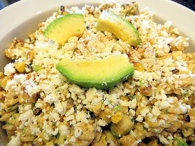 Elote Pasta Salad - mixing pasta, pan roasted corn, cotija cheese and avocado