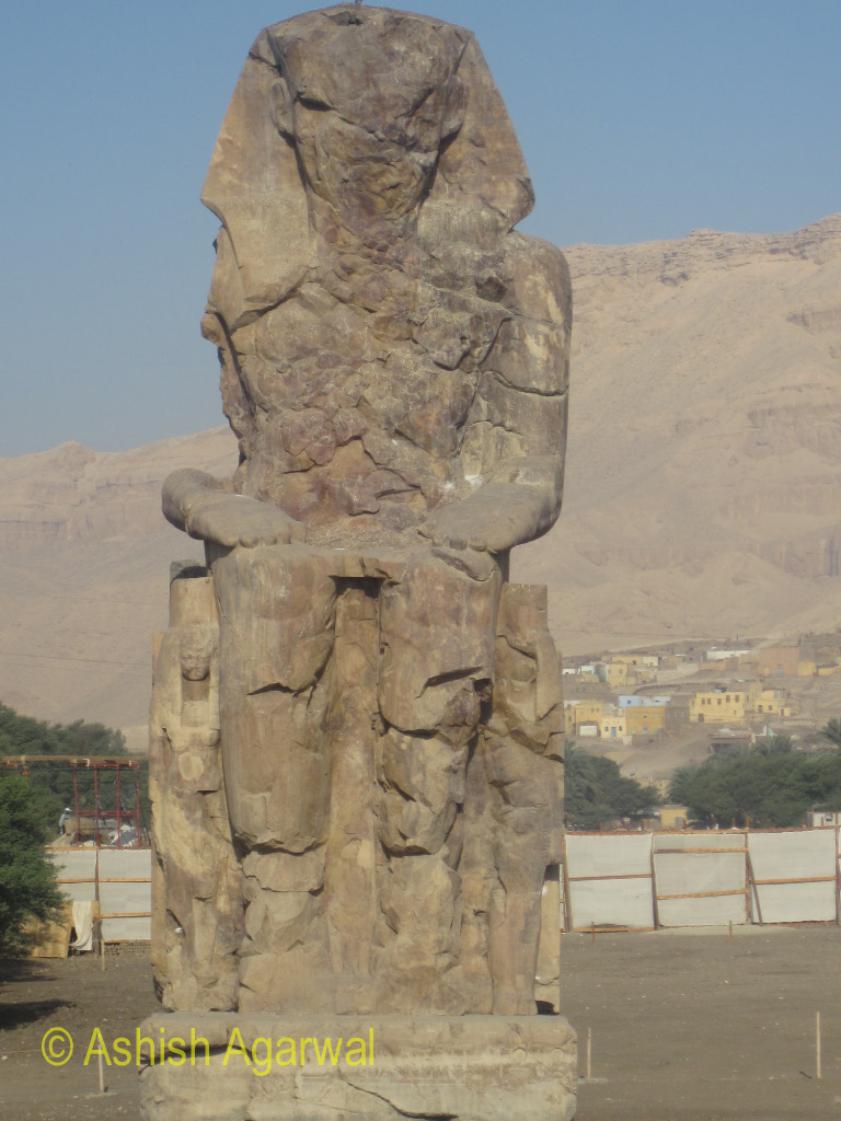 The statues of the Colossi of Memnon, one of the 2 large statues depicting the Pharaoh Amenhotep III in the countryside surrounding Luxor, Egypt