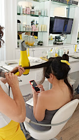 The bride to be enjoys a mimosa and getting a blowout at adorables blowout salon Drybar in LA. She got the hairstyle option of Cosmo-Tai, a blend of the Cosmo of lots of loose curls and the Mai Tai that hints at messy beachy hair.
