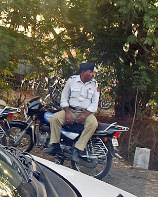 policeman sitting on bike