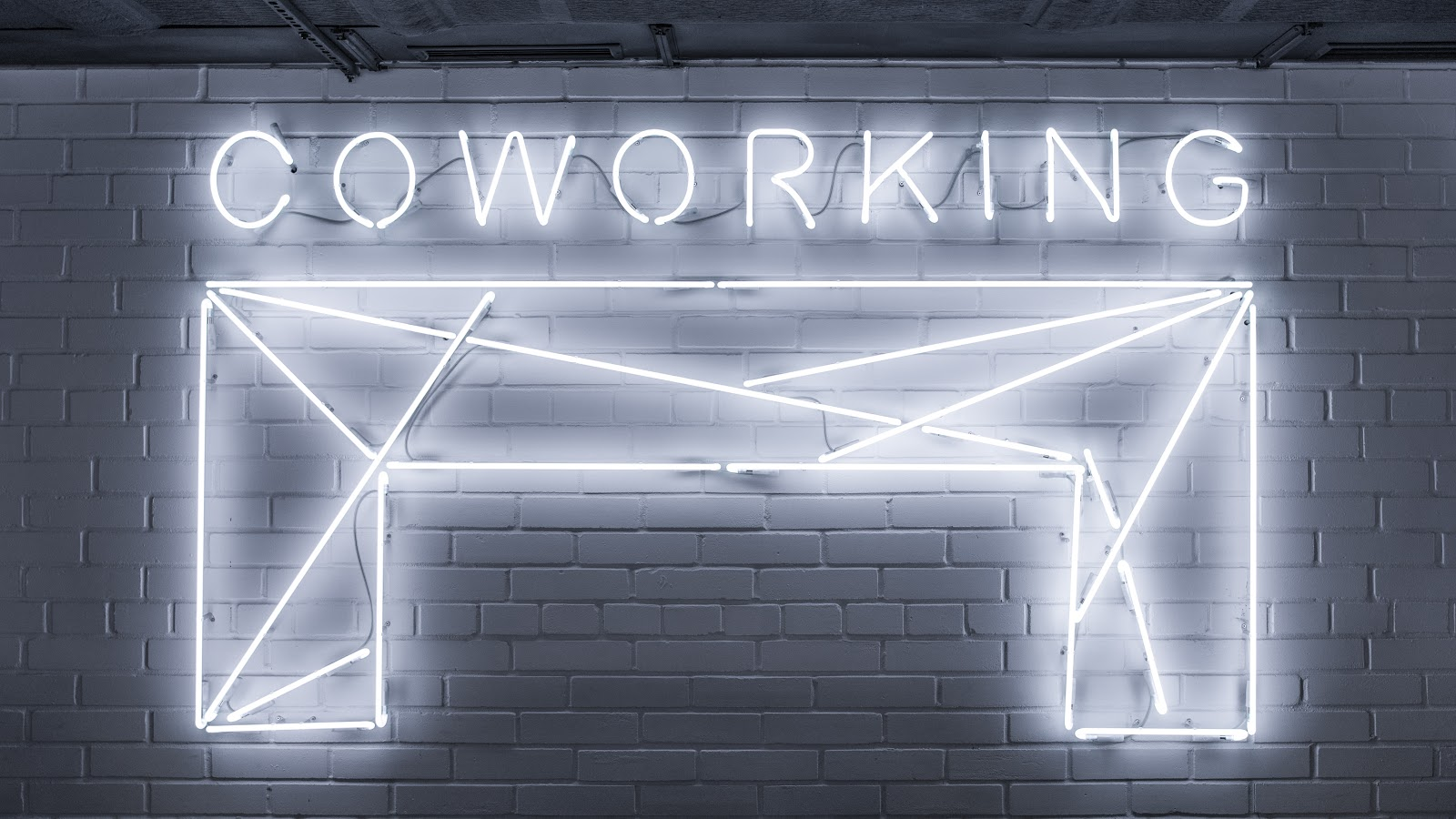 """Neon sign that says """"Coworking""""."""