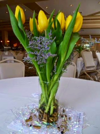 Flowers in a vase of rifle casings at the 2nd Annual women's concealed carry fashion show