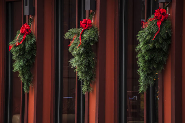 Wreaths on red building