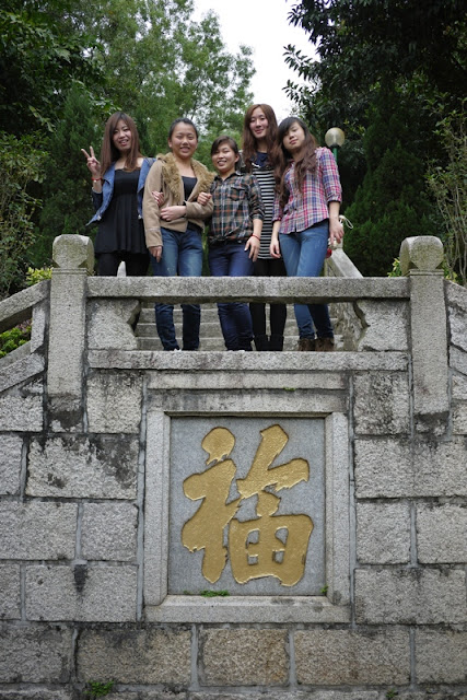 Young women standing above the character 福 (fu) at Bailian Dong park in Zhuhai China