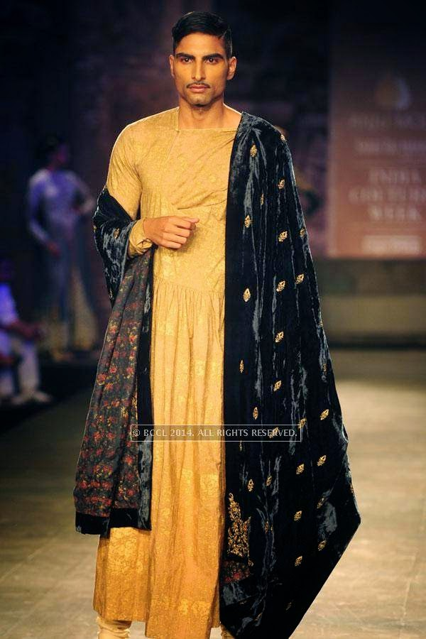 A male model walks the ramp for Anju Modi on Day 2 of India Couture Week, 2014, held at Taj Palace hotel, New Delhi.