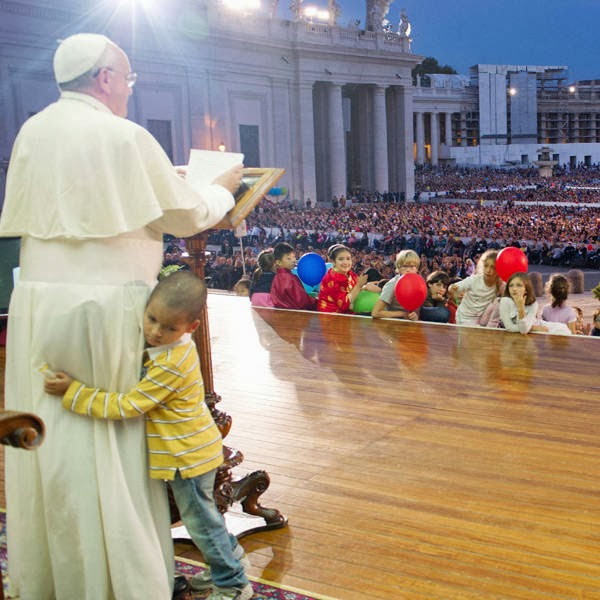 The Vatican says Francis was surrounded by elderly faithful and their grandchildren Saturday night at a rally to encourage family life when the boy came up, wearing a striped shirt, jeans and sneakers.