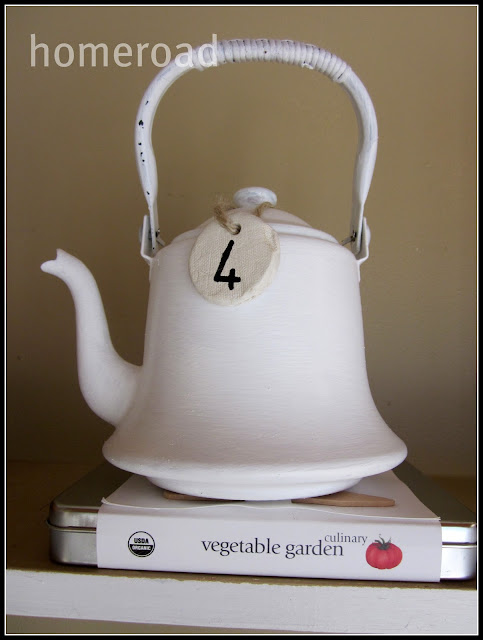 clay tag on white teapot