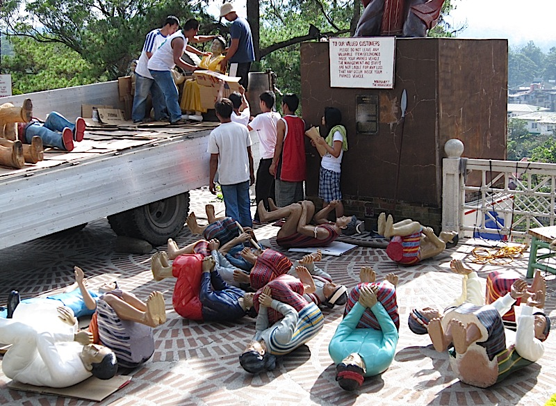 figurines being arranged in front of Kamayan restaurant in Baguio City