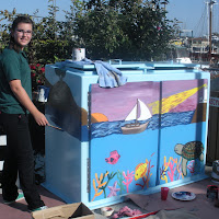 Heather Camp with one of the finalist designs painting her box at the Ventura Harbor for the HS Competition 2009.