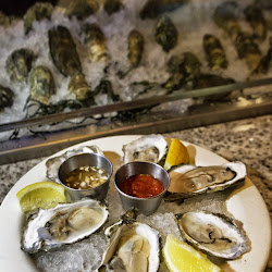 Naked Oyster Bistro and Raw Bar's profile photo