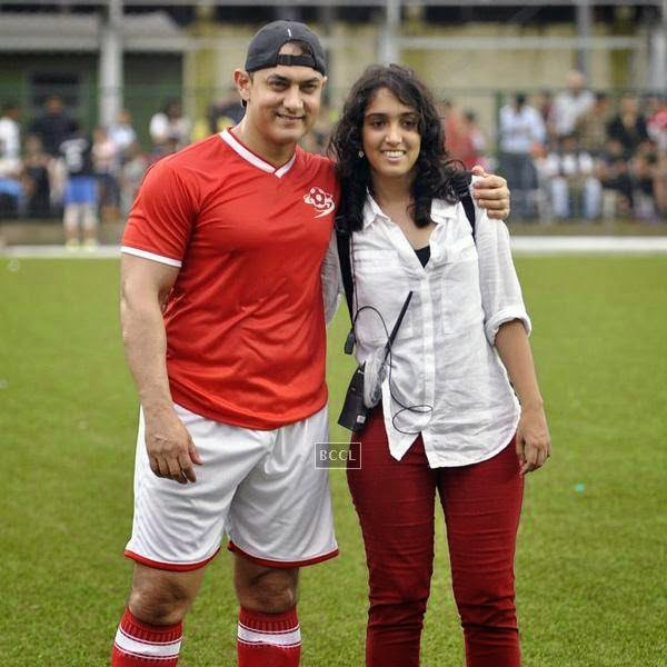 Aamir Khan poses with his daughter Ira Khan during a charity soccer match organised by her, at Cooperage ground, on July 20, 2014.(Pic: Viral Bhayani)