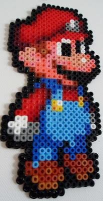 Pixel art made out of perler beads. Close up of mario