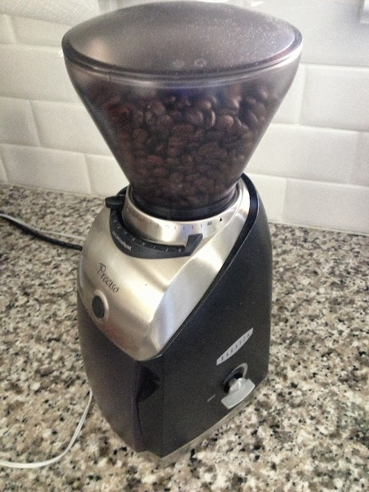 The Baratza Preciso Conical Burr Coffee Grinder loaded with fresh coffee beans and ready to grind away.