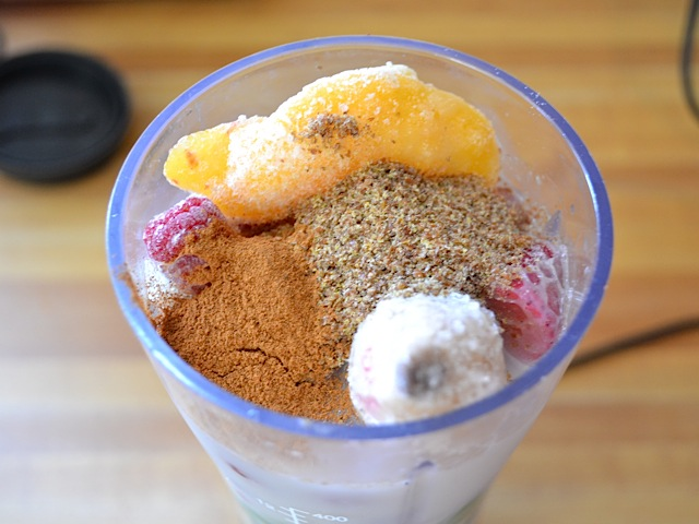 flax and cinnamon added to blender with fruit for flavor