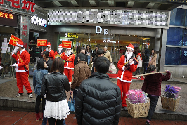several young men dressed up as Santa Claus for a promotion at a shopping center in Changsha, China