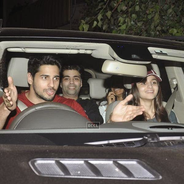 Sidharth Malhotra, Alia Bhatt and Karan Johar arrive for the screening of a movie, in Mumbai, on July 24, 2014. (Pic: Viral Bhayani)