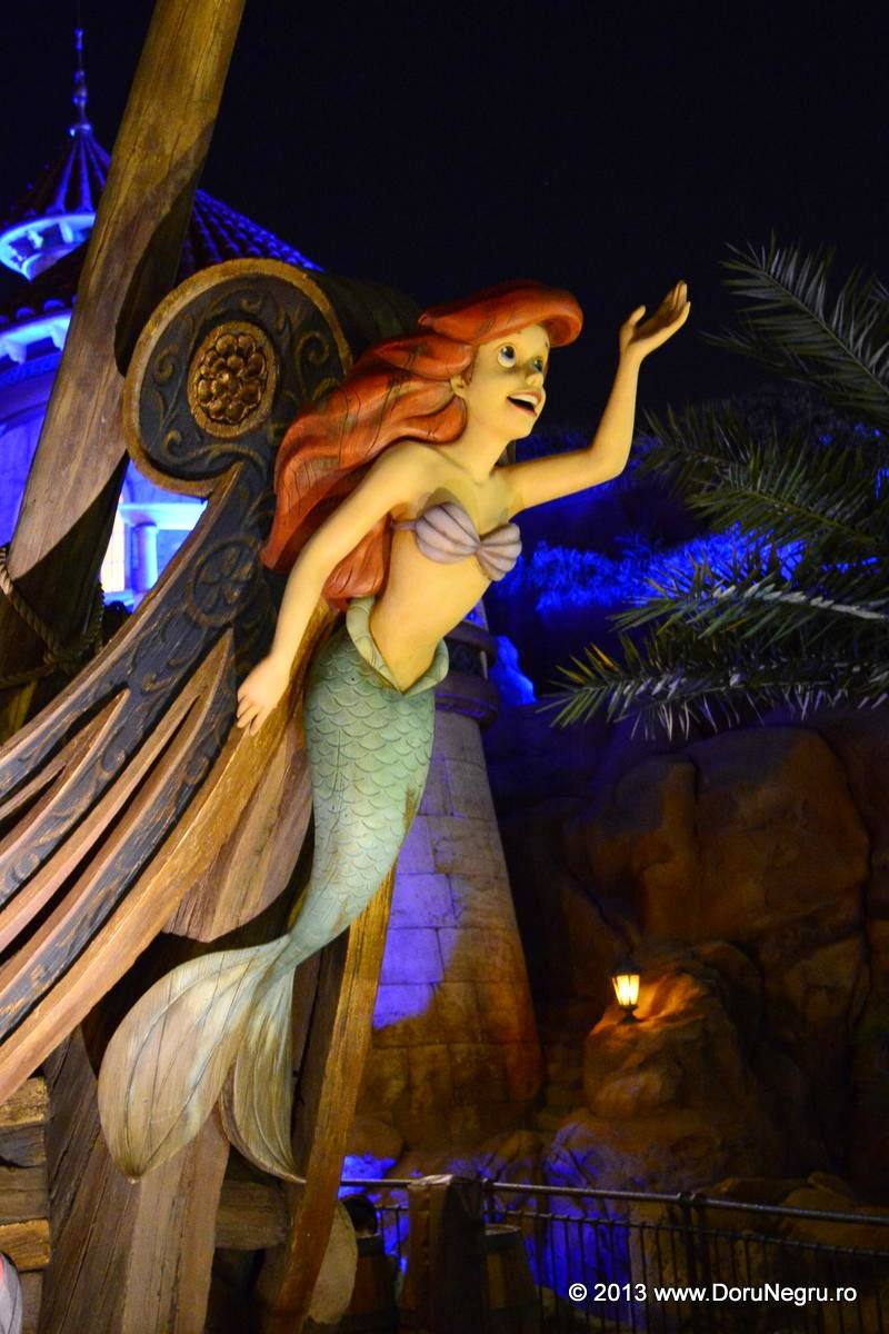 The little mermaid at the bow of a ship, Disney World, Orlando, FL