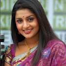 Meera Jasmine in Transparent Saree  Cute Photos