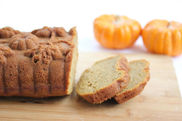 photo of two slices of Pumpkin Tea Cake with the rest of the loaf