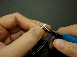 Cut the earwires at the same time.