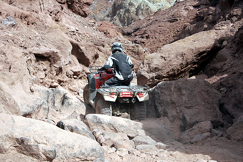 250cc Semi Auto Jianshe Quad Bike JS250ATV-5 ATV Over Rocks Rugged Terrain