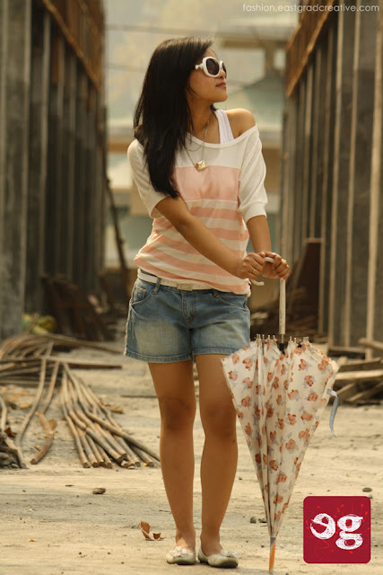 Off shoulder soothing tees,denim shorts,pump shoes and a matching umbrella to beat the heat.