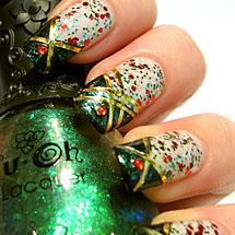 unhas brancas decoradas com glitter verde para o Natal