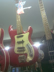 red electric guitar made famous by David Bowie hanging in muse shop